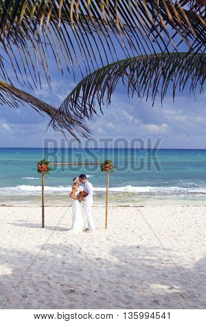 Latin couple celebrating their wedding in the Mayan Riviera, Mexico.