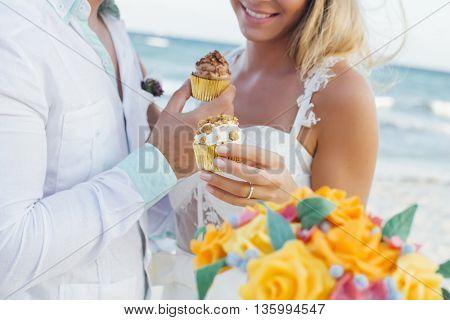 Latin couple having sweet cupcakes at their wedding