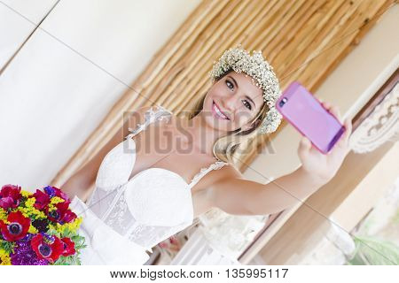 Beautiful bride taking a selfie after her getting ready