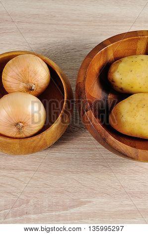 onions ans potatos close up on wood