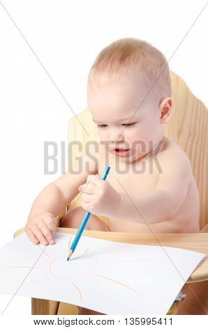 A boy draws with a pencil isolated on white background