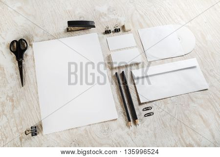 Photo of blank stationery set and ID template on wooden table background. Mock-up for branding identity for designers. Blank branding mock-up.