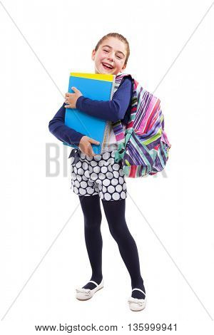 Preschool student girl carrying notebooks and backpack on white background
