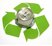 A photo of a crushed aluminum can in the middle of the recycle logo