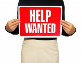 A photo of a business woman holding a help wanted sign