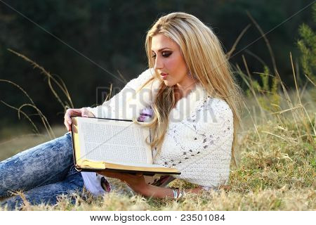 Blonde Lady Reading Bible