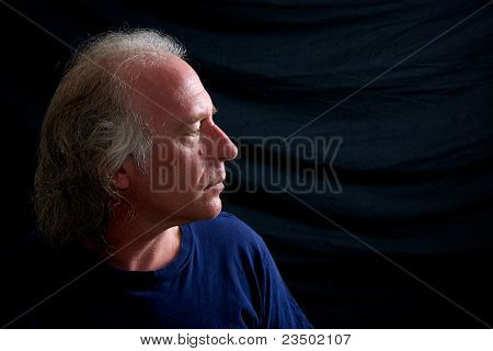 Profile Of Older Man Looking Right