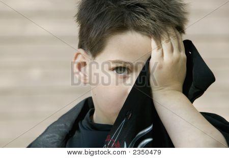 Boy Hiding His Face