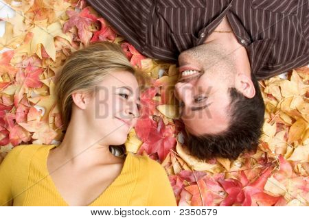 Couple In Leaves