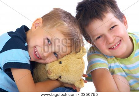 Happy Brothers And Teddy Bear