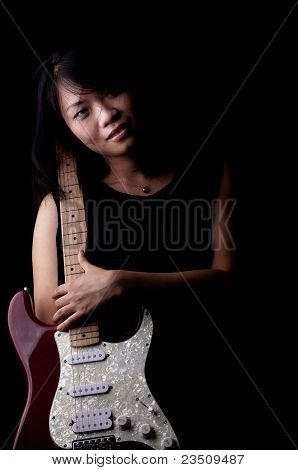 Young Woman With Electronic Guitar