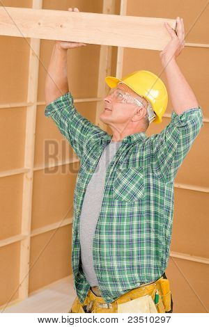 Handyman Carpenter Mature Fitting Wooden Beam