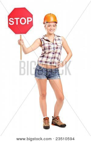 Full length portrait of a construction worker holding a traffic sign stop isolated on white background