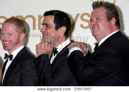 LOS ANGELES - SEP 18:  Jesse Tyler Ferguson, Ty Burrell, Eric Stonestreet in the Press Room at the 63rd Primetime Emmy Awards at Nokia Theater on September 18, 2011 in Los Angeles, CA