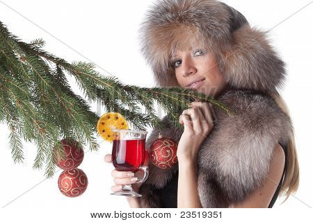 Young Woman In Fur With Glass Of Mulled Wine.