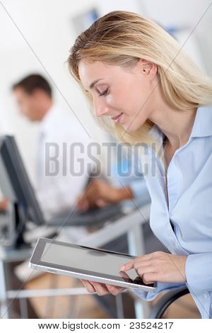 Protrait of office worker using electronic tablet