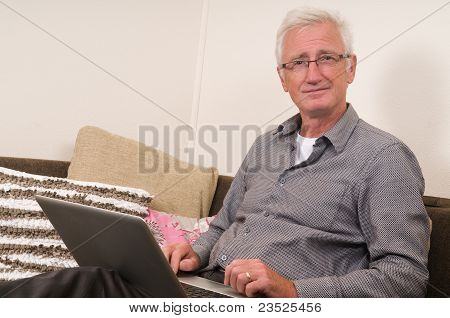 Senior Working On A Laptop