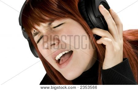 Cute Redhead Enjoying Music
