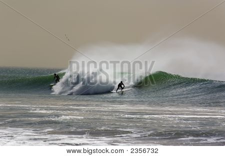 Two Surfers On A  Winter Wave
