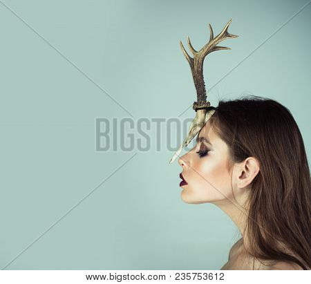 Woman With Makeup And Antlers