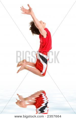 Leaping Child Hands Stretched To Sky