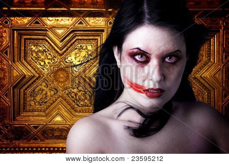 Woman vampire with blood in his mouth. Gothic Image halloween over gold background