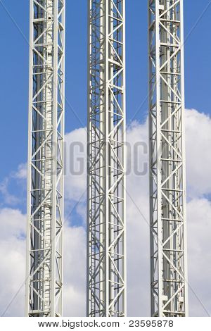Metal towers over cloud background