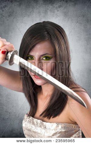 beautiful female warrior holding katana sword ready for the attack