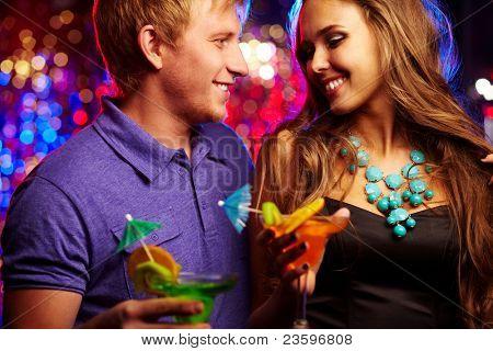Image of happy couple having fun in the night club