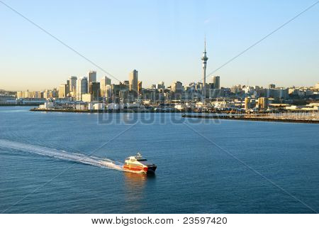 ferry passing by Auckland Harbor in sunrise light, New Zealand