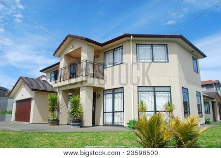 luxury home with landscaped front yard