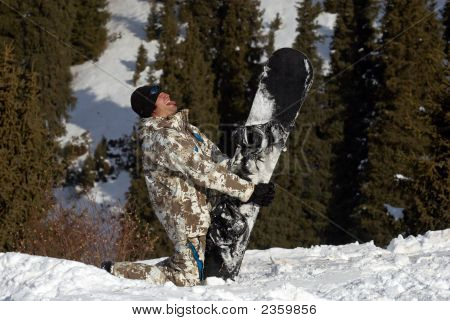 Merry Snowboarder Play The Fool On Ski Slope