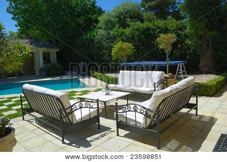 Stylish outdoor terrace with swimming pool
