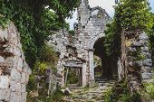 Ancient Stone Ruins And Ivy Temple Wall Archway At Old Bar Town On Montenegro. Stari Bar - Ruined Me poster