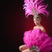 Beautiful Girl In Carnival Costume With Rhinestones And Pink Feathers. Beautiful Professional Make-u poster