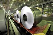 foto of shipbuilding  - packed rolls of steel sheet inside of factory - JPG