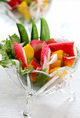 stock photo of mange-toute  - Crab stick with pepper and lettuce salad - JPG