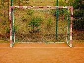 Soccer Football Net Background Over Green Grass And Blurry Stadium. Close Up Detail Of A Soccer Net  poster