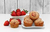 Freshly Baked Organic Strawberry Muffins, With Whole Fresh Berries. poster