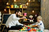 Dad And Child Play With Toy Cars, Bricks. Father And Happy Son Play With Constructor. Fatherhood Con poster