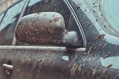 Close-up Image Of A Dirty Car After A Trip Around The Countryside. poster