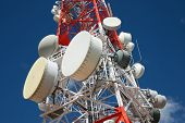 Telecommunications tower with blue sky. poster