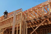 New House Framework Of House Under Construction Post And Beam Construction poster