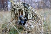 Постер, плакат: Military Man Armed Sniper Rifle Gun In Combat Position Armed Man In Soldier Camouflage With Sniper