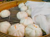 Various Types Of  Steamed Buns Or Siopao Buns In Bamboo Steamer poster