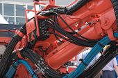 Large Red Excavator Or Tractor With Bucket For Coal Mining Or Transportation In Industry At The Exhi poster