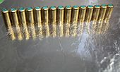 Abstract Image With Silver And Gold Brass Surfaces, Gun Bullets Line poster