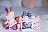 Childrens Shoes And Clothes On The Bed. Beautiful Pink Baby Clothes. Newborn. Home Cosiness. Baby. poster