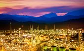 Oil Refinery At Dramatic Twilight.oil Storage Tank With Oil Refinery Background, Oil Refinery Plant  poster
