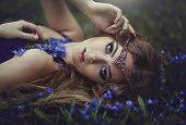 Elf Girl With Long Hair And Blue Eyes In The Tiara Rests In Spring Forest Blue Forest Flowers. Girl  poster